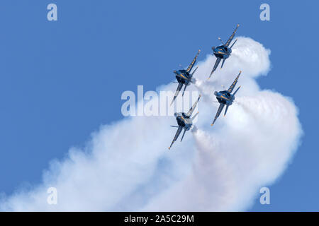 Blue Angels F-18 Hornets in diamond formation during a 2019 San Francisco Fleet Week flight demonstration. - Stock Photo