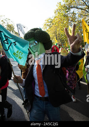 London, UK. 19th October 2019. Mr Broccoli or Mr Roland Everson, the well-known activist seen with Animal Rebellion protesters at a demonstration in Hyde Park, London. Credit: Joe Kuis / Alamy News Stock Photo