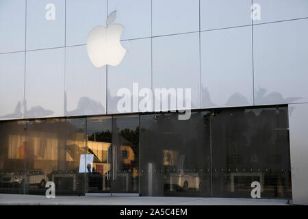 A logo sign outside of a Apple Store location in Greensboro, North Carolina on September 15, 2019. - Stock Photo