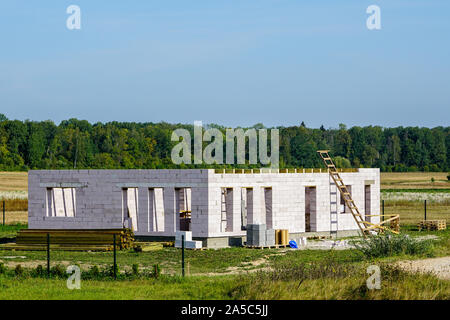 Concrete foundation of a new house, view of construction site in preparation process - Stock Photo