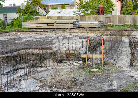 grilles of reinforcing steel made of welded bars for concreting the foundations of the house - Stock Photo