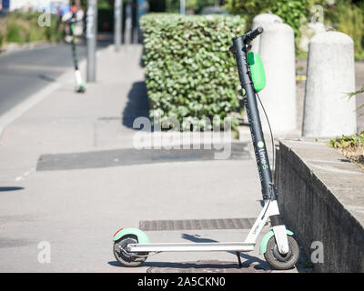LYON, FRANCE - JULY 13, 2019: Lime logo on one of their electric scooters in Lyon. Lime is a transportation company specialized in dockless electric s - Stock Photo