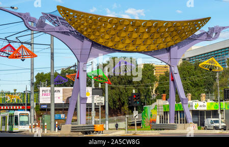 Gateway and streetlights of colourful metal conical hats homage to Vietnamese culture in Victoria Street Richmond Melbourne Victoria Australia. - Stock Photo