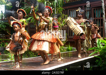Traditionally Dressed Dance Group of Women, Men and Children on their Way to the Stage - Stock Photo