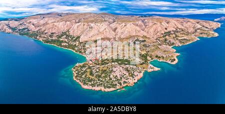 Stara Baska. Aerial panoramic view of Stara Baska village and stone desert landscape of Krk island, Kvarner bay of Croatia - Stock Photo