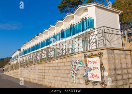 Poole, Dorset UK. 20th October 2019. UK weather: dry but chilly start to the day with some sunshine, as visitors head to the seaside to make the most of the weather. Beach huts at Branksome Dene Chine. Credit: Carolyn Jenkins/Alamy Live News - Stock Photo