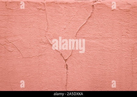 Texture of a painted pink wall with cracks. Plastered concrete wall. Abstract background. - Stock Photo