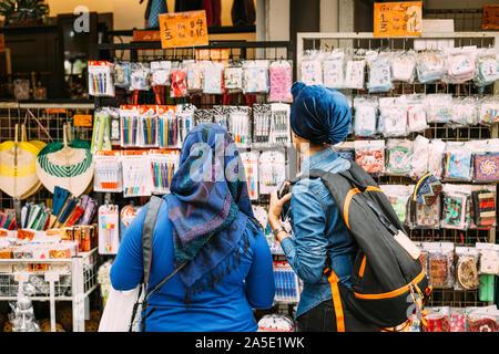 Singapore-21 JUL 2018:people choose gift on outdoor shopping street - Stock Photo