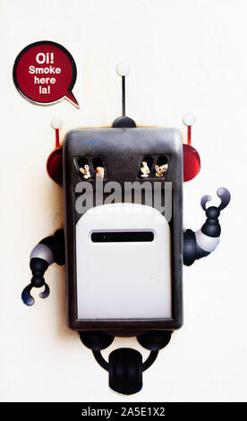 cute robot can on the wall for smoke space - Stock Photo