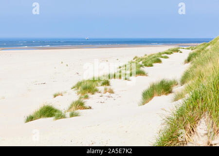 A nearly white beach at the North Sea in Norderney, Germany. - Stock Photo