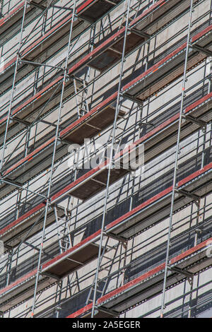 A picture of scafolding in the facade of a builting in Andorra la Vella. - Stock Photo