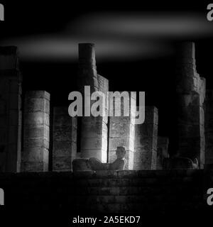 Chac Mool rests upon the top of the Temple of Warriors at Chichen-Itza, Yucatan, Mexico. - Stock Photo