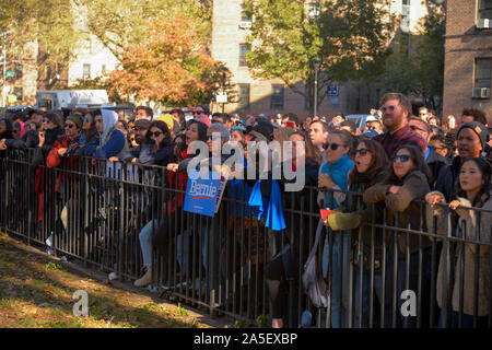 NEW YORK, NY - OCTOBER 19: Supporters of Democratic presidential hopeful, Vermont Senator Bernie Sanders attend a Bernie's Back rally in Queensbridge - Stock Photo
