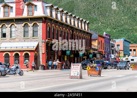 Silverton, USA - August 14, 2019: Small town in Colorado with city main street and sign on road by historic architecture and hotel - Stock Photo