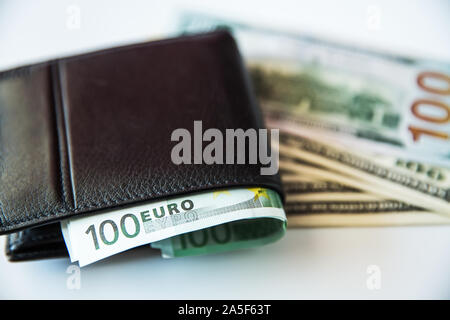 Currency in the wallet and on the table. - Stock Photo