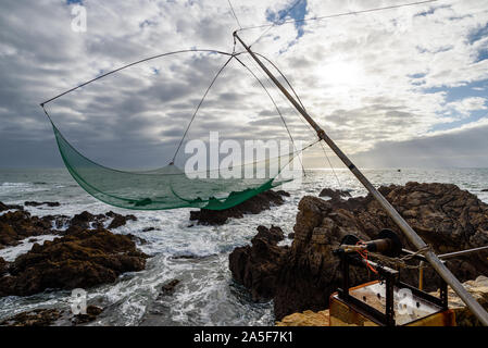 Net fishing gear along the atlantic coast in Le Pouliguen, Loire-Atlantique department, western France. - Stock Photo