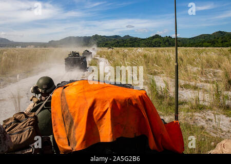 """U.S. and Philippine Marine light armored vehicles move toward the objective during the final exercise of KAMANDAG 3 at Colonel Ernesto P. Ravina Air Base, Oct. 17, 2019. Exercises such as KAMANDAG 3 increase our ability to work together in response to crises across the military spectrum in order to accomplish the mission, support the local population, and help alleviate human suffering. KAMANDAG 3 is a Philippine-led, bilateral exercise. KAMANDAG is an acronym for the Filipino phrase """"Kaagapay Ng Mga Manirigma Ng Dagat,"""" which translates to """"Cooperation of the Warriors of the Sea,"""" highlightin - Stock Photo"""