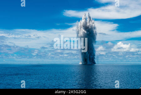 191014-N-SS432-0217  PACIFIC OCEAN (Oct. 17, 2019) Sailors assigned to Underwater Construction Team TWO (UCT 2) Construction Dive Detachment /Bravo (CDD/B) detonate explosives on an obstruction in the Sapwauhfik Atoll, Federated States of Micronesia on Oct. 17, 2019 as part of Triggerfish 2019 phase III. Triggerfish is a U.S. Third Fleet-led mission that employs expeditionary forces to conduct hydrographic surveys and clear hazards to navigation in the Federated States of Micronesia in order to ensure a free and open Indo-Pacific. (U.S. Navy photo by Mass Communication Specialist 2nd Class Oma - Stock Photo