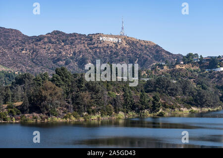 Los Angeles, California, USA - October 13, 2019:  View of the famous Hollywood sign and reservoir lake near Griffith Park. - Stock Photo