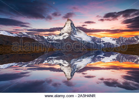 Matterhorn peak reflected in Stellisee Lake in Zermatt, Switzerland. - Stock Photo