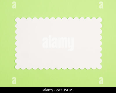 White name plate for copy space on green background - Stock Photo