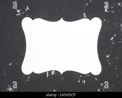 White name plate for copy space on a black concrete background - Stock Photo