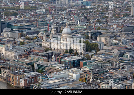 An aerial view looking north over St. Pauls Cathedral inLondon, showing the Cathedral surrounded by other buildings. - Stock Photo
