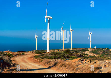 Wind turbine power generator farm  on a hillside