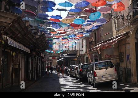 The colorful umbrellas of the Umbrella Sky Project in Via Gisira and Via Pardo, Catania, Sicly, Italy,