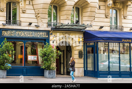 street scene in front of paris-france hotel - Stock Photo