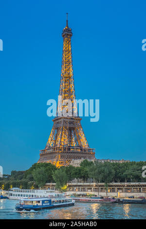 eiffel tower and sightseeing boats on river seine - Stock Photo