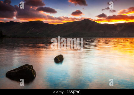 Sunset over Derwent Water from Ashness landing stage, Lake District, Cumbria, England, UK - Stock Photo