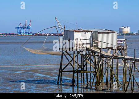 Carrelet and industry along the Loire river at Saint-Nazaire, Loire-Atlantique, France - Stock Photo