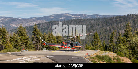 YOSEMITE NATIONAL PARK, USA - SEPTEMBER 13, 2019 : Resuce helicopter on the helipad at the Crane Flat fire lookout in Yosemite Park, California. - Stock Photo