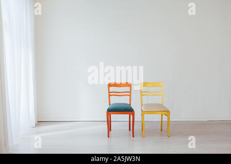 two vintage chairs in the interior of an empty white room - Stock Photo