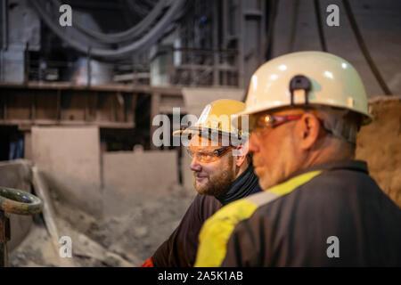 Portrait of steelworkers in steelworks