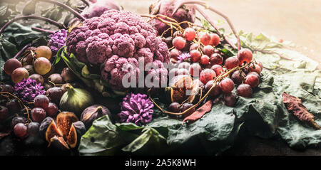 Various autumn purple fruits and vegetables, close up - Stock Photo