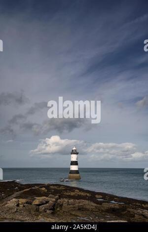 Trwyn Du Lighthouse near Penmon on Angelsey in North Wales - Stock Photo