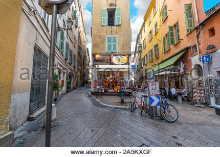 One of the many sharp corners and turns in the twisty, winding Old Town of Vieux Nice, France, on the French Riviera. - Stock Photo