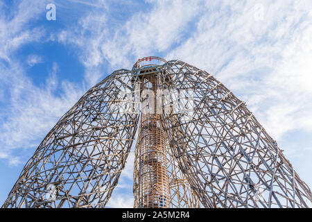 Prague, Czech Republic - October 2019: Doubravka lookout tower. Wooden structure made of locust tree. At the edge of Prague. Nice sky in the - Stock Photo
