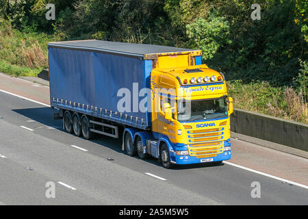 Tyneside Express Haulage delivery trucks, storage, lorry, transportation, truck, cargo, Scania vehicle, delivery, transport, industry, supply chain freight, on the M6 at Lancaster, UK - Stock Photo