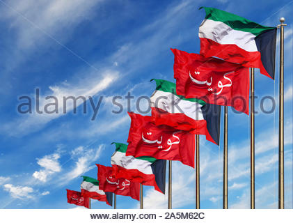 Kuwait Flag Poles Waving In The Wind On A Blue Sky Backdrop - Stock Photo