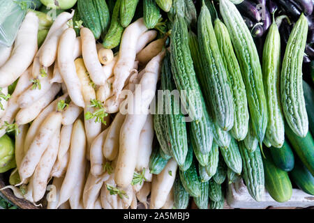 Various vegetables on the counter. organic fresh fruits and vegetables on grocery counter. Selling vegetables in Asia.
