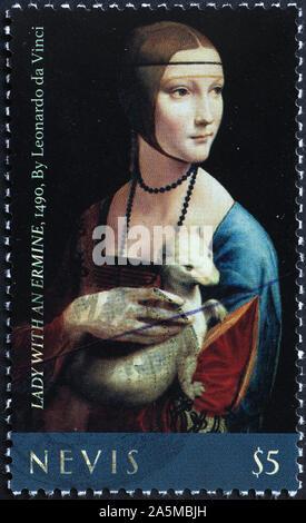 Lady with an ermine by Leonardo on postage stamp - Stock Photo