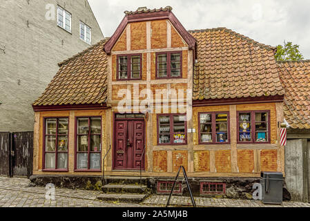 Shop and hairdresser in a red half-timbered house in  Ebeltoft, Denmark, September 9, 2019 - Stock Photo