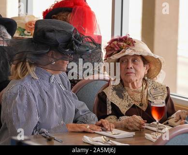 Two senior ladies in period clothing enjoying a day at the track. Photo was taken at Arizona Downs, Prescott Valley, Arizona on Ladies Day.