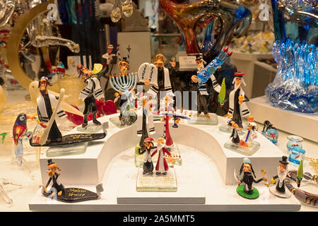 A display of Murano small Murano glass sculptures with Jewish themes. In Venice, Italy. - Stock Photo
