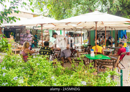 Praia do Forte, Brazil - Circa September 2019: Outdoor cafe at the main street of Praia do Forte, popular beach near Salvador, Bahia - Stock Photo