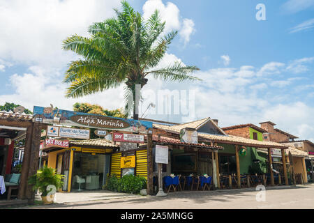 Praia do Forte, Brazil - Circa September 2019: Restaurants and shops at the main street of Praia do Forte, popular beach resort near Salvador, Bahia - Stock Photo