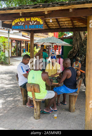 Praia do Forte, Brazil - Circa September 2019: Men playing domino at Praia do Forte, popular beach resort near Salvador, Bahia - Stock Photo